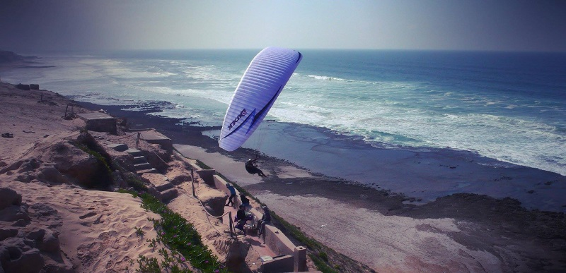 Aziz Elmssaid flies from his spot at Aglou Beach