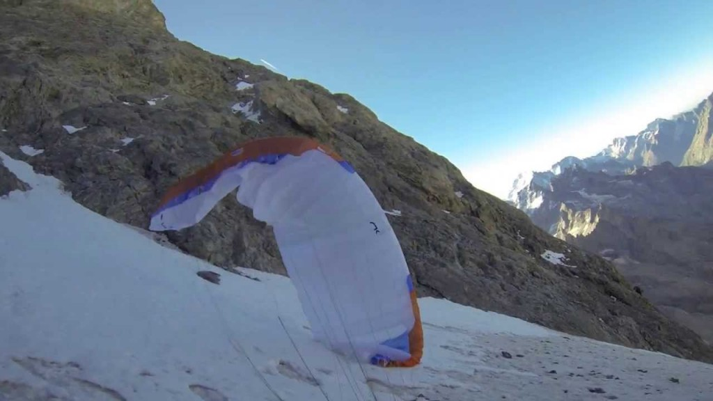 Julien Irilli launches from the Carré Glacier on the Niviuk SKIN